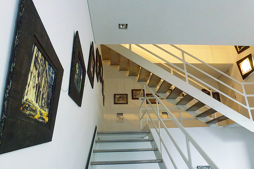 Our exhibition starts ascending the stairs...